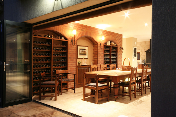 Dining room by homify, Rustic Bricks