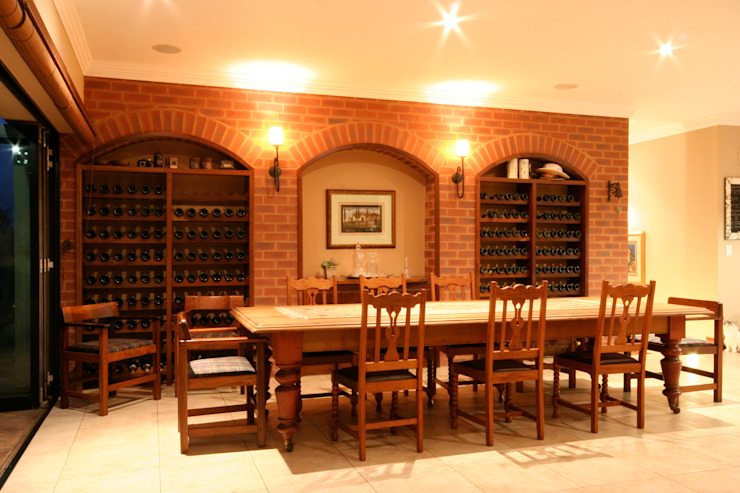Dining and Wine cellar by homify Colonial Bricks