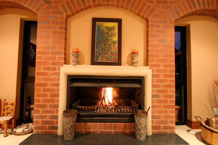 Fire place by homify Classic Bricks