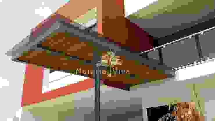 Pasillos, vestíbulos y escaleras de estilo moderno de Materia Viva S.A. de C.V. Moderno