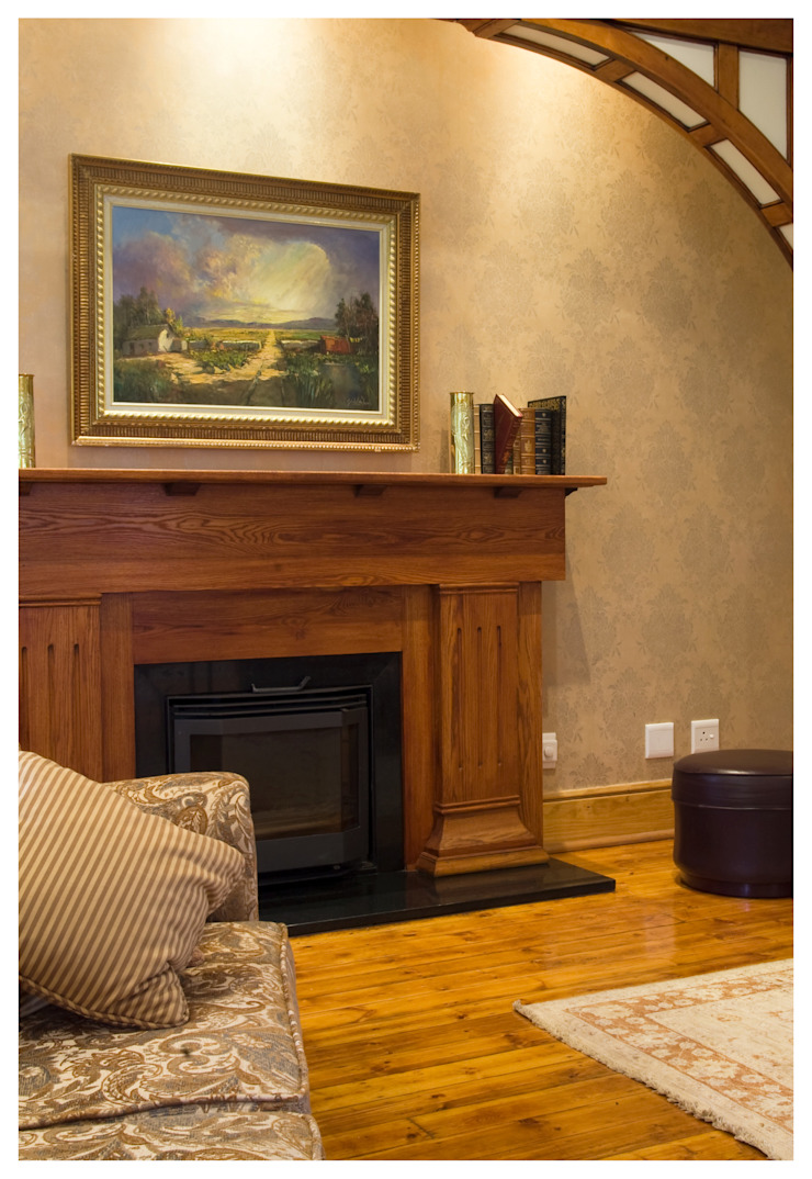 living room with fire place by Nuclei Lifestyle Design Classic