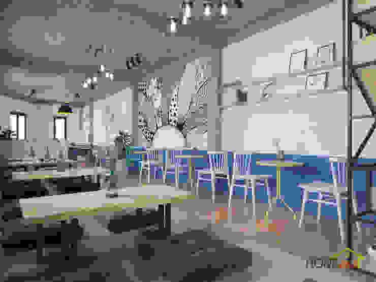 Không gian quán trà sữa có phần ngồi bệt và phần ngồi cao bởi Home Office Bắc Âu