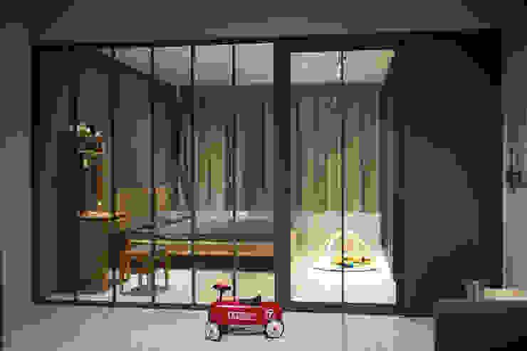 Dormitorios de estilo  por 日常鉄件製作所