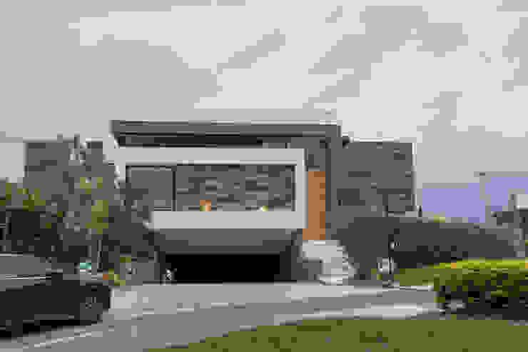 Casas unifamiliares de estilo  por homify, Moderno