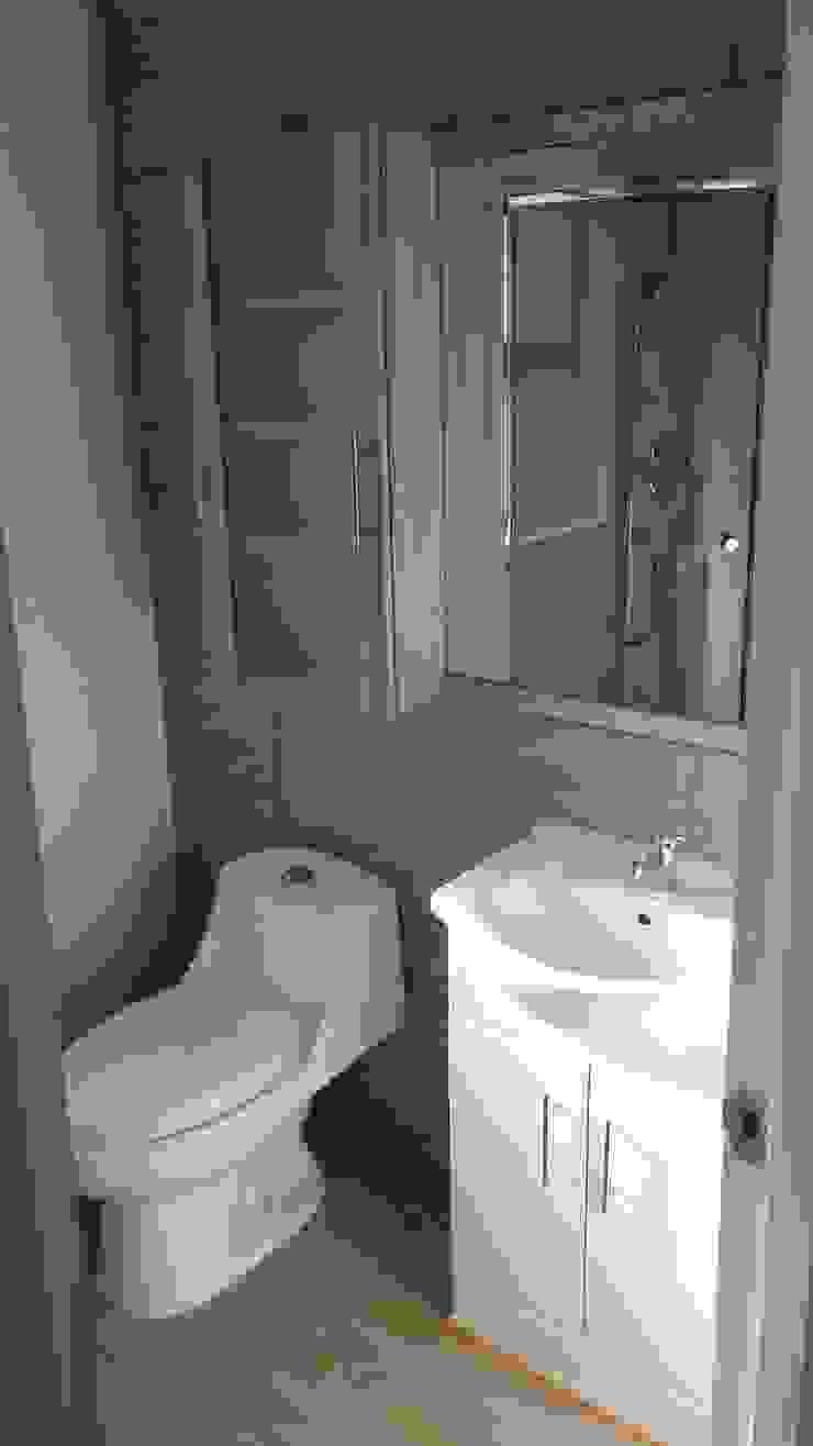 Casa Gral.Cruz Lau Arquitectos Baños de estilo moderno