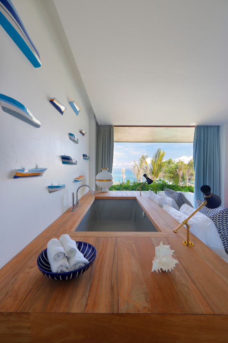Seascape Bedroom with a bathtub Tropical style bedroom by Word of Mouth House Tropical