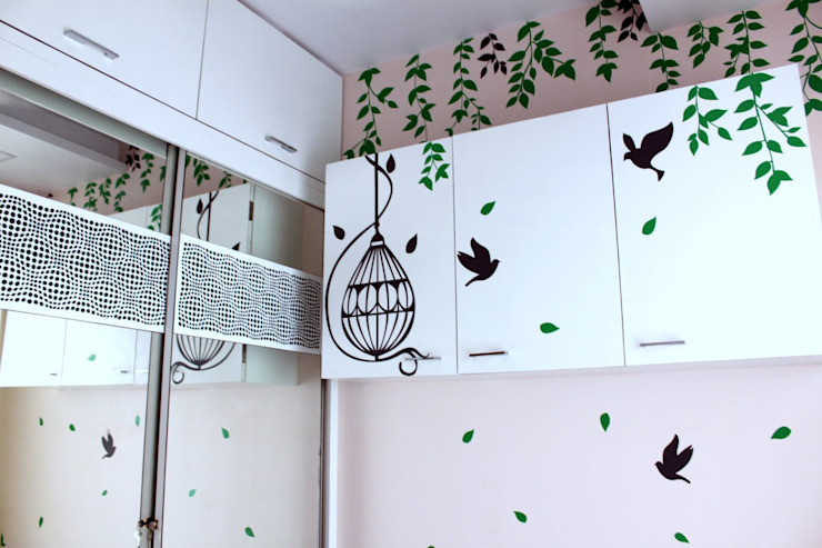 Guest Room Overhead units with decals Modern style bedroom by Dezinebox Modern