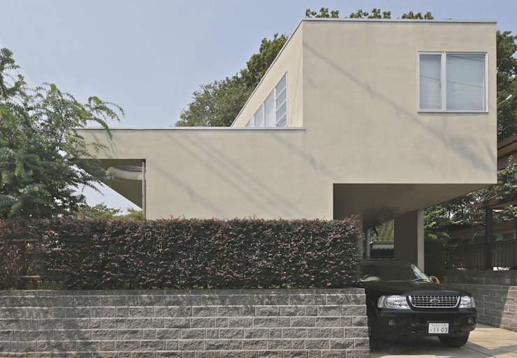 シンプルモダン:こだわりを持つ若夫婦のための家 JWA,Jun Watanabe & Associates モダンな 家