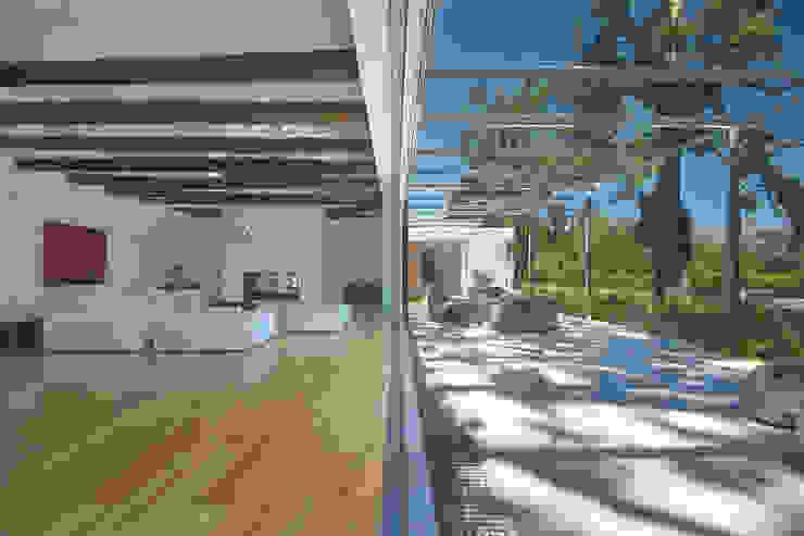 Living room and stoep Modern Living Room by Van der Merwe Miszewski Architects Modern Wood Wood effect