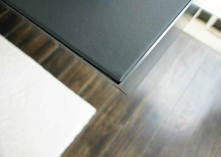 Detail of top counter in leather and steal. Studioapart Interior & Product design Barcelona Living room