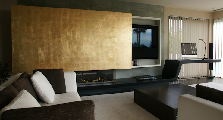 Fireplace and sliding panel. Studioapart Interior & Product design Barcelona Living room