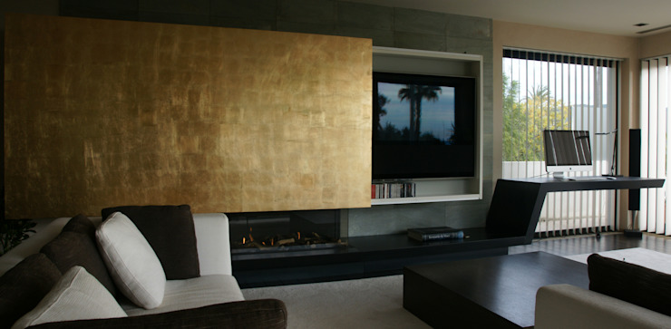 Fireplace desktop and TV set integrated. Studioapart Interior & Product design Barcelona Living room