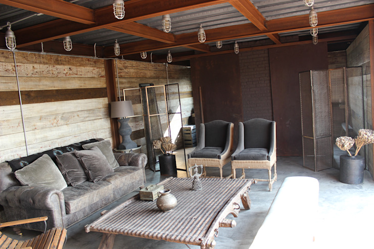 Rustic style living room by Tema Arquitectos Rustic