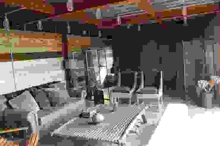 Salon rustique par Tema Arquitectos Rustique