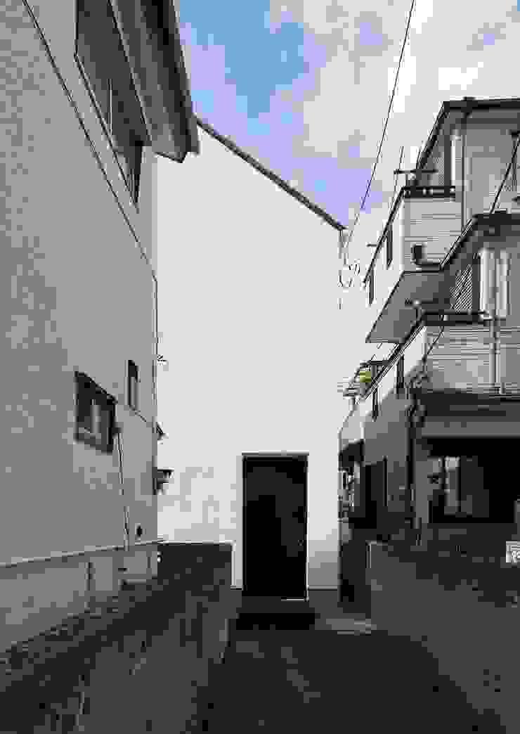 Casas de estilo minimalista de 石川淳建築設計事務所 Minimalista Madera Acabado en madera