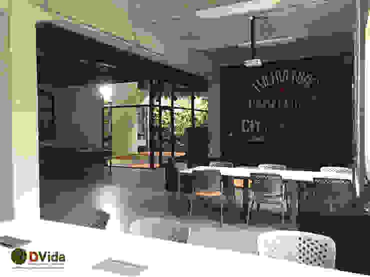 Muros verdes en centros educacionales Estudios y bibliotecas de estilo tropical de DVida Jardines verticales Tropical