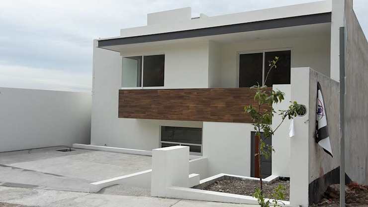 FACHADA PRINCIPAL de RIVERA ARQUITECTOS Moderno Cerámico