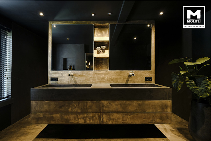 Woonhuis in Hengelo Molitli Interieurmakers Industriële badkamers Beton Amber / Goud