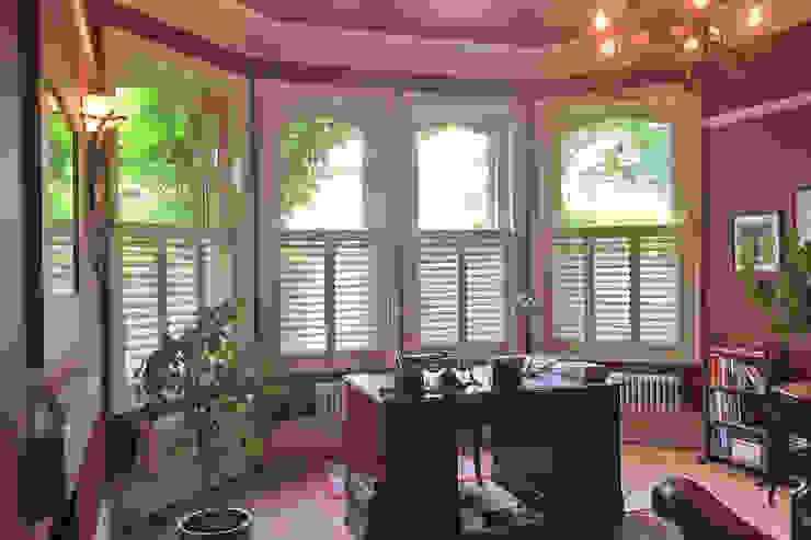 Cafe Style Shutters in a Home Office Plantation Shutters Ltd Ruang Keluarga Klasik