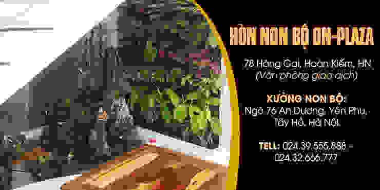 Phong thủy hòn non bộ dưới chân gầm cầu thang bởi Công Ty Thi Công Và Thiết Kế Tiểu Cảnh Non Bộ Châu Á