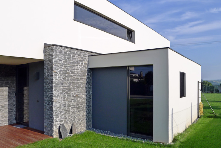 Vivienda en Pravio de AD+ arquitectura Moderno Piedra