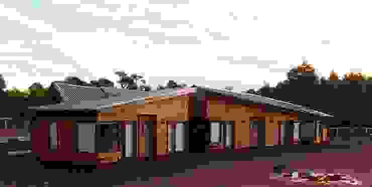 Vista Fachada Norte de Nomade Arquitectura y Construcción spa Clásico Madera Acabado en madera