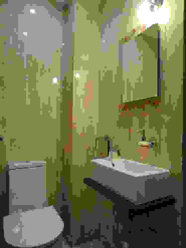 Remodelação de apartamento - Instalação Sanitária Banheiros modernos por PROJETARQ Moderno