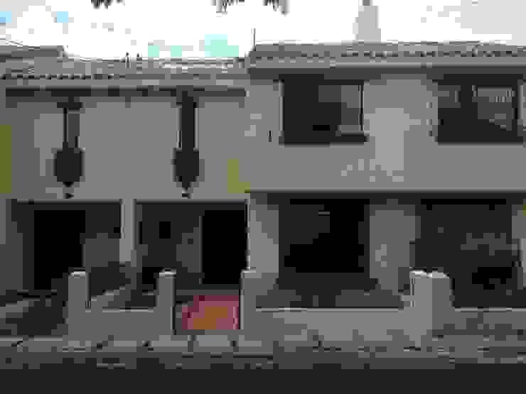 Erick Becerra Arquitecto Single family home Concrete Yellow
