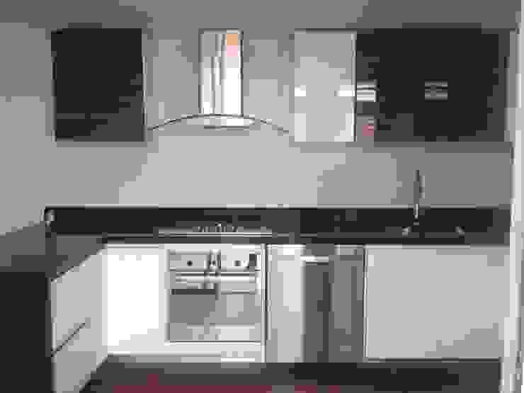 Erick Becerra Arquitecto Built-in kitchens Engineered Wood Wood effect