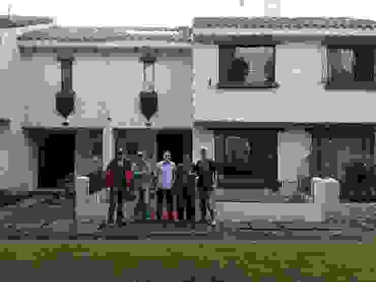 Erick Becerra Arquitecto Single family home Concrete Amber/Gold