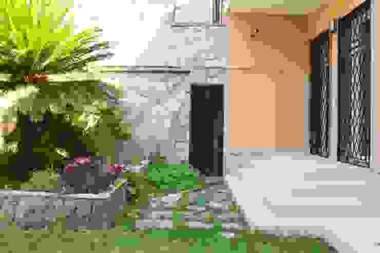 Simmetria tra gradinata e vecchia aiuola rialzata Francesco Ruffa Architetto Giardino moderno