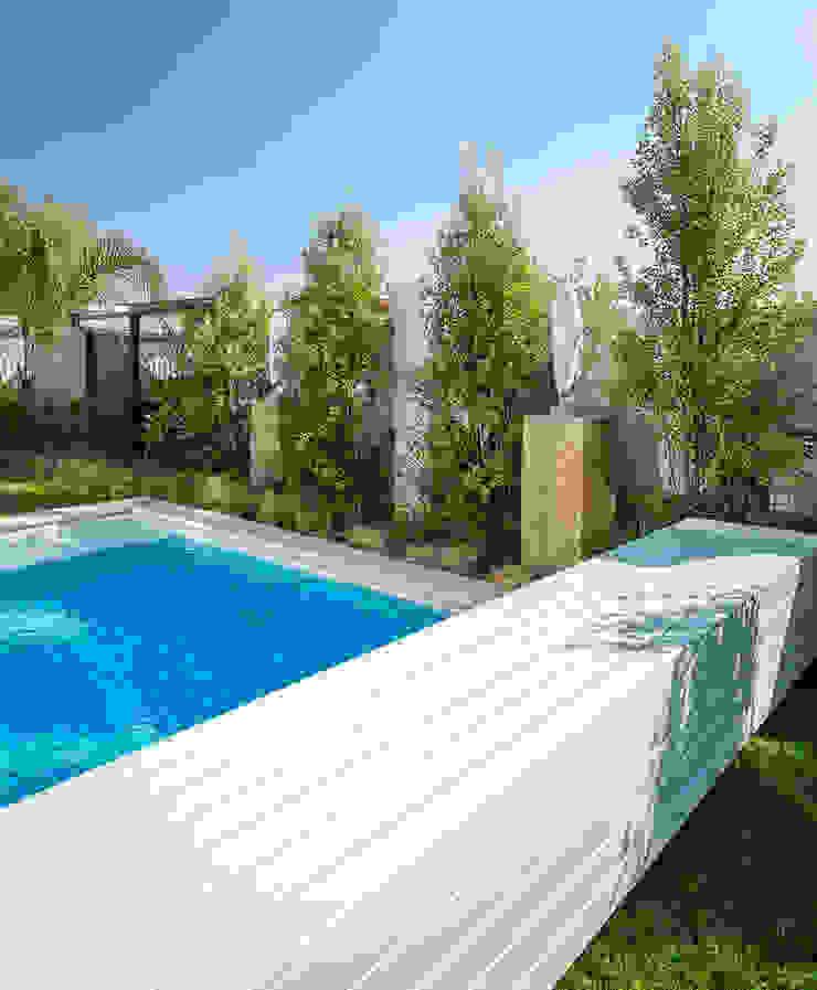 Pool with Automated Cover by Deborah Garth Interior Design International (Pty)Ltd Modern Quartz