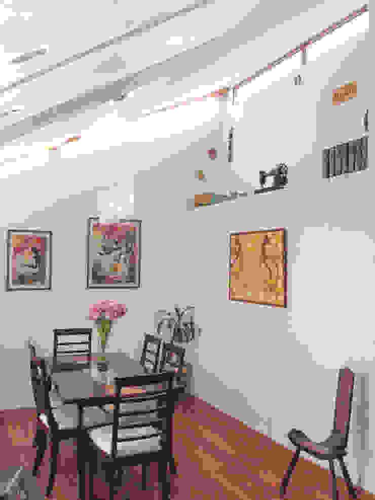Comedor con doble altura Comedores de estilo moderno de Arqbau Ltda. Moderno Concreto