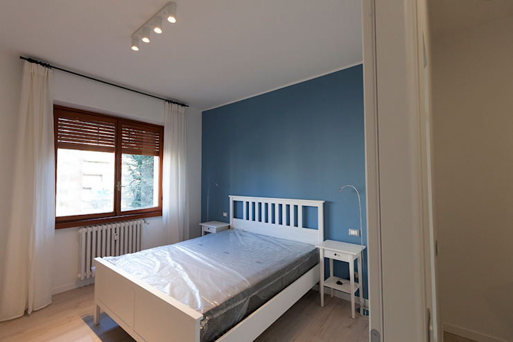 Modern style bedroom by Laura Galli Architetto Modern