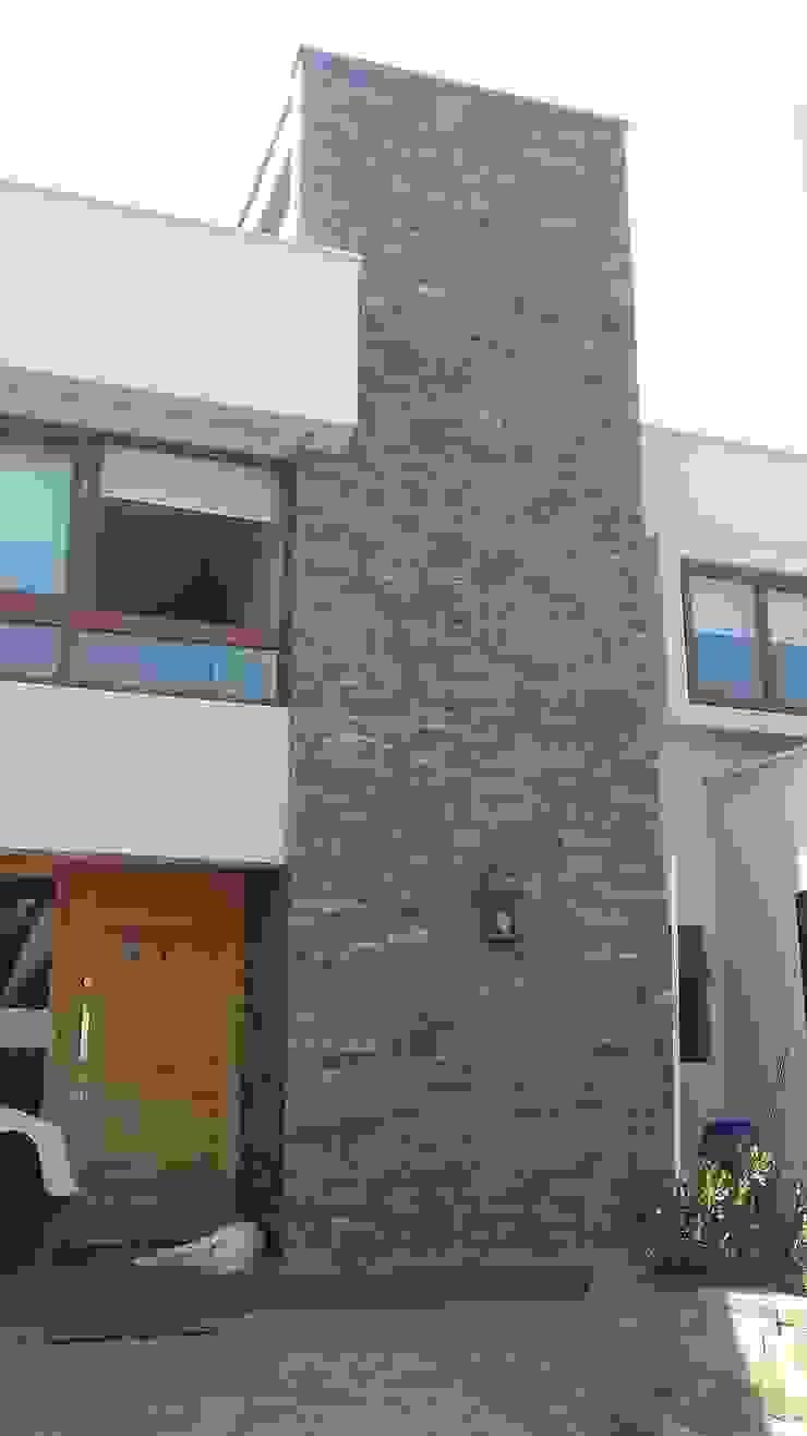 CASA TRONCOSO de AOG Moderno Piedra