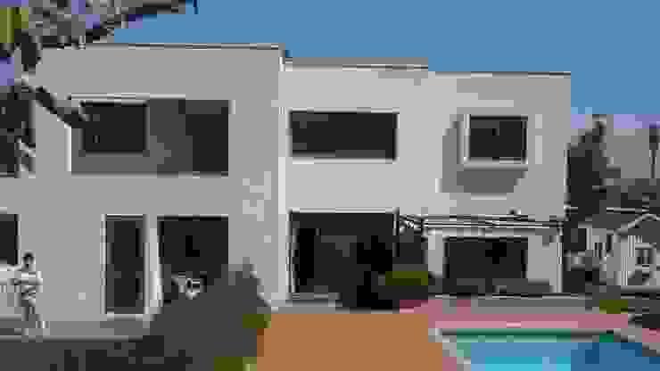 CASA TRONCOSO AOG Casas estilo moderno: ideas, arquitectura e imágenes Concreto Blanco