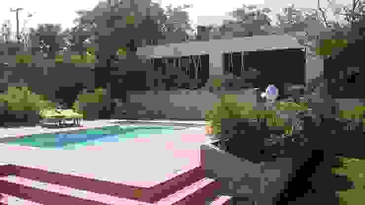 CASA TRONCOSO Balcones y terrazas modernos de AOG Moderno Concreto