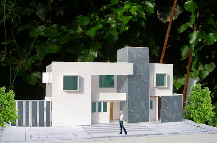 CASA TRONCOSO AOG Casas unifamiliares Concreto Blanco