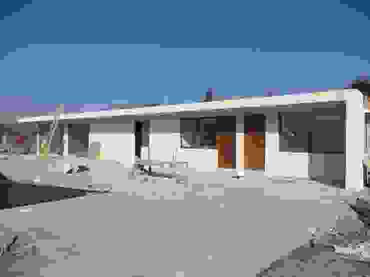 CASA DONOSO Casas de estilo minimalista de AOG Minimalista Ladrillos