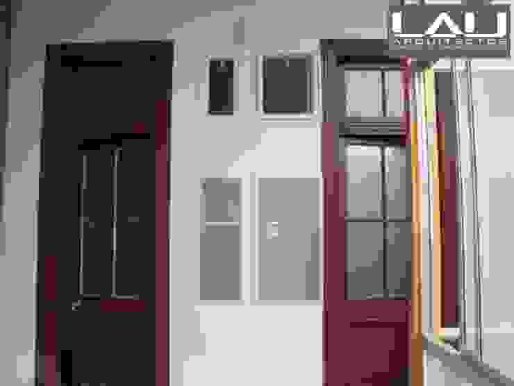 Loft Playa Ancha Paredes y pisos modernos de Lau Arquitectos Moderno