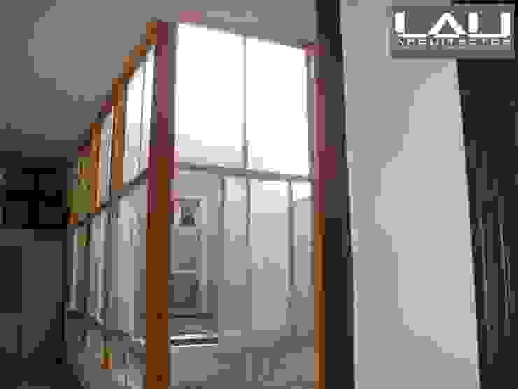 Loft Playa Ancha Puertas y ventanas modernas de Lau Arquitectos Moderno