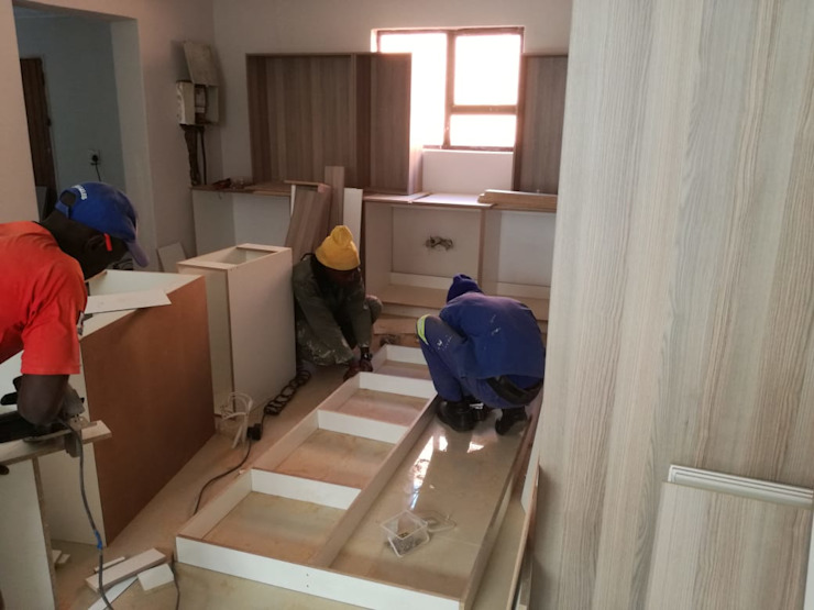 Mounting cabinets and building the island. Day 2' by Pulse Square Constructions