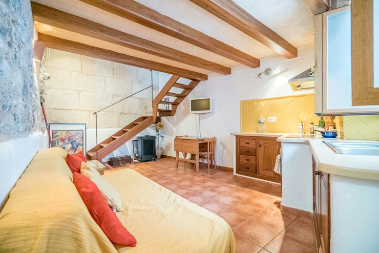 House completely restored in Dalt Vila Classic style bedroom by ibizatophouse Classic
