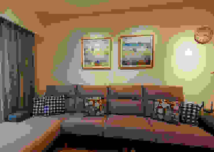 客廳 根據 致室內設計個人工作室