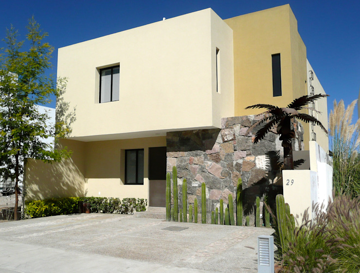 Fachada de estilo rústico contemporáneo Alberto M. Saavedra Detached home Stone Beige