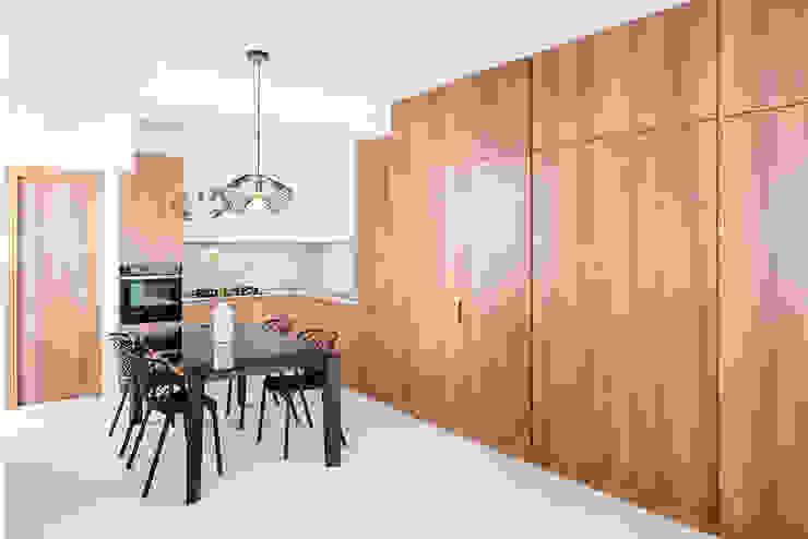 Area Cucina di manuarino architettura design comunicazione Minimalista Legno Effetto legno