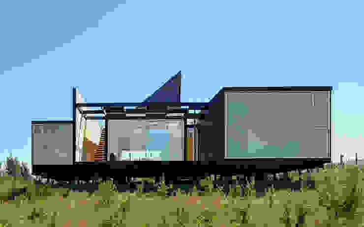Fachada Oriente Casas estilo moderno: ideas, arquitectura e imágenes de mutarestudio Arquitectura Moderno