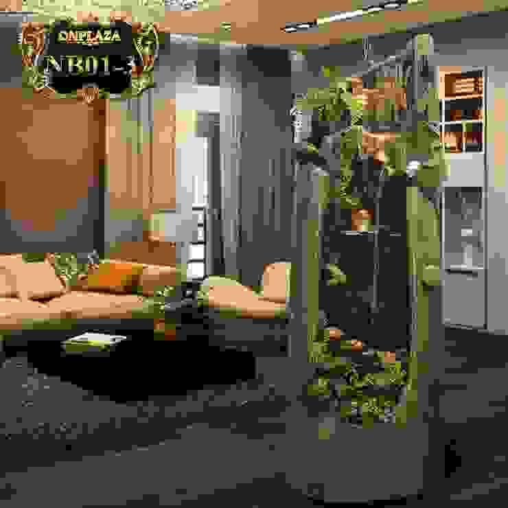 Hòn non bộ mini có thác nước trong thân cổ thụ đặt trong phòng khách bởi Công Ty Thi Công Và Thiết Kế Tiểu Cảnh Non Bộ