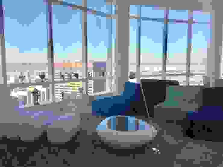 Grand Residence: Salas de estilo  por Studio ARI,