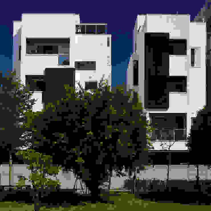 與樹為鄰的建築 根據 黃耀德建築師事務所 Adermark Design Studio 簡約風